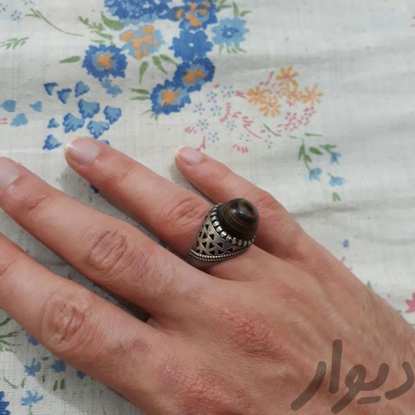 انگشتر سه پوست|جواهرات|مسجد سلیمان|دیوار
